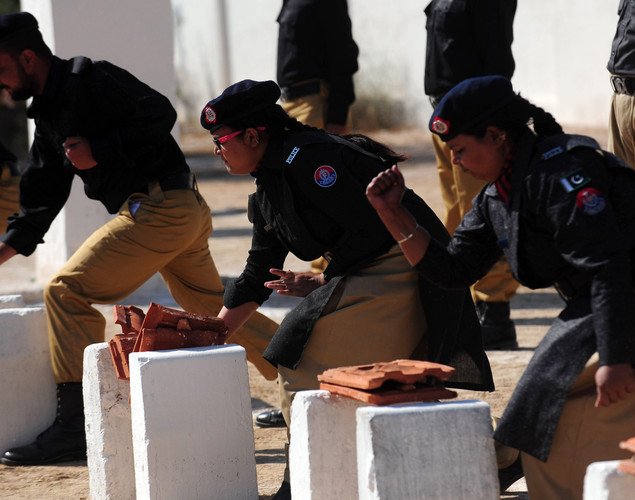 Pakistani police cadets perform during passing out parade in Karachi.