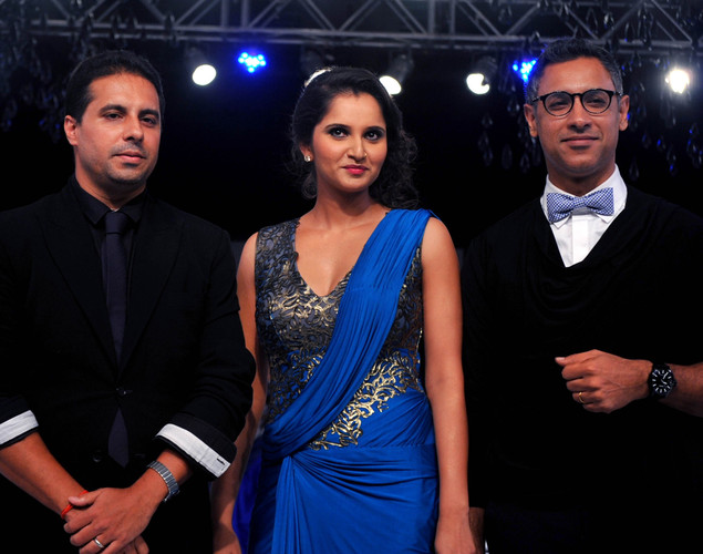 Indian Tennis Player Sania Mirza (C) displays a creation by designer Shantanu and Nikhil at the 8th edition of Seagram's Blenders Pride Fashion Tour 2012 in Mumbai.