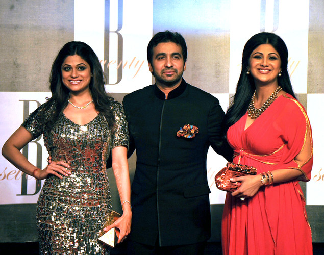 Indian Bollywood actress Shilpa Shetty (R) poses with her husband Raj Kundra (C) and her sister Samita Shetty (L)as they attend the 70th Birthday celebrations of Bollywood Actor Amitabh Bachchan in Mumbai.