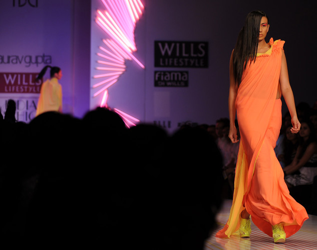 A model presents a creation by Indian designer Gaurav Gupta during the third day of the Wills India Fashion Week Spring- Summer collection 2013 in New Delhi.