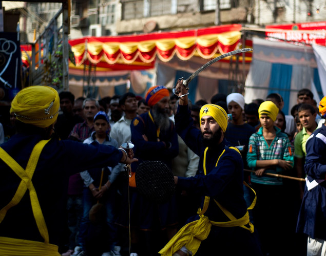 Indian Sikh Nihangs - warriors - demonstrate their 'gatka' skills during a religious procession in New Delhi on November 27, 2012 on the eve of the 543rd birth anniversary of Sri Guru Nanak Dev.
