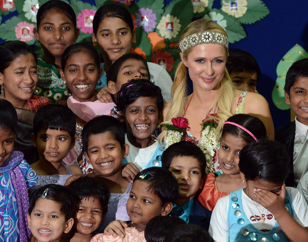 Paris Hilton poses with children during a visit to an orphanage in Mumbai.