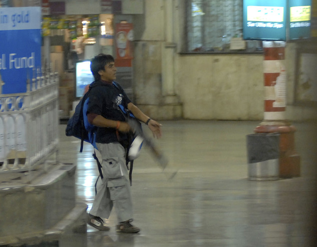 In this Nov. 26, 2008 file photo, Mohammed Ajmal Kasab, the accused gunman in the 2008 bloody siege of Mumbai walks at the Chatrapathi Sivaji Terminal railway station in Mumbai, India.