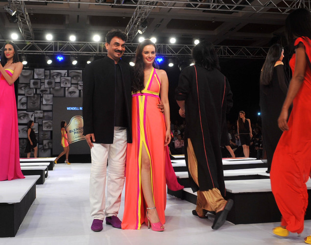 Bollywood actress Evelyn Sharma (C) displays a creation by designer Wendell Rodricks at the 8th edition of Seagram's Blenders Pride Fashion Tour 2012 in Mumbai.