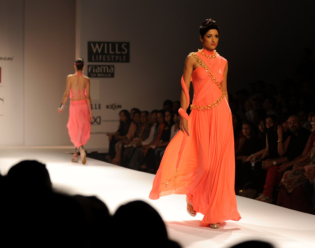 A model presents a creation by Indian designer Malini Ramani during the fourth day of the Wills India Fashion Week Spring- Summer collection 2013 in New Delhi.