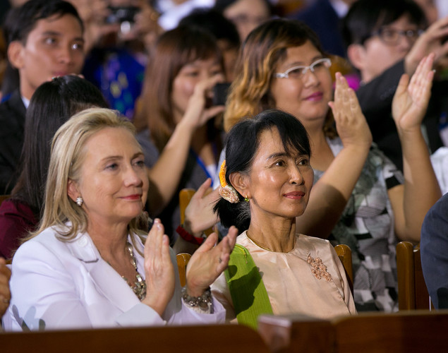 US Secretary of State Hilary Clinton (L) listens alongside Aung San Suu Kyi as US President Barack Obama speaks at the University of Yangon during his historical first visit to the country.
