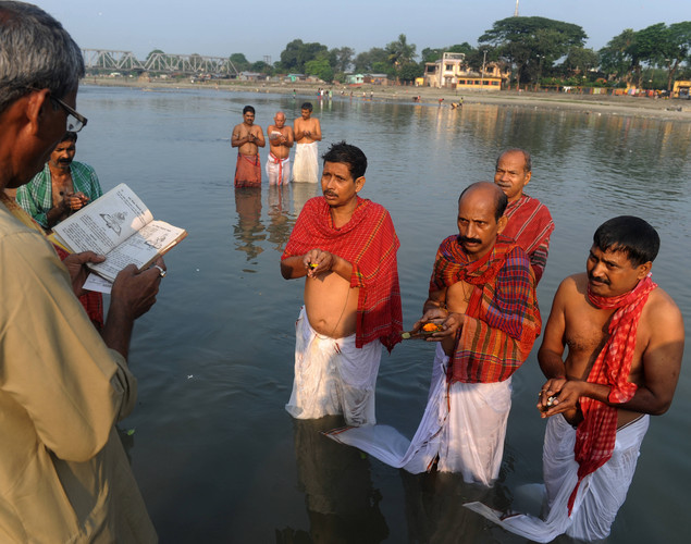 Indian Hindu devotees perform 'Tarpan', a ritual to pay obesience to one's forefathers, on the last day of 'Pitrupaksh' - days for offering prayers to ancestors - on the banks of the river Mahananda in Siliguri.