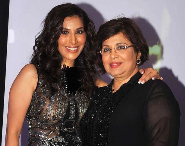 Bollywood film actress and singer Sophie Choudry (L) poses with her mother during the launch of her new video 'Hungama Ho Gaya', a remix of the yesteryear song, in Mumbai.