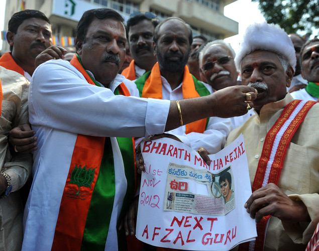 Members of the opposition Bharatiya Janata Party(BJP) distribute sweets as they celebrate the execution of Pakistan-born Mohammed Kasab, the sole surviving gunman of the 2008 Mumbai attacks, in Hyderabad.