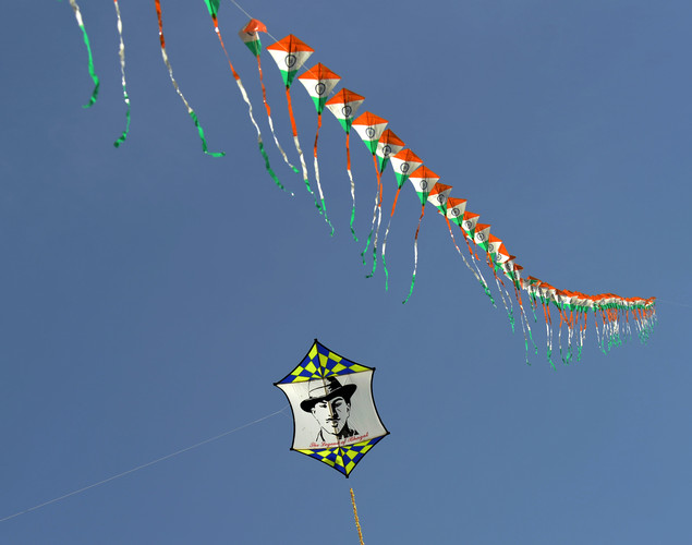 A kite displays an image of Indian freedom fighter Bhagat Singh during the Delhi International Kite Festival 2012 on the lawns of the India Gate monument in New Delhi.