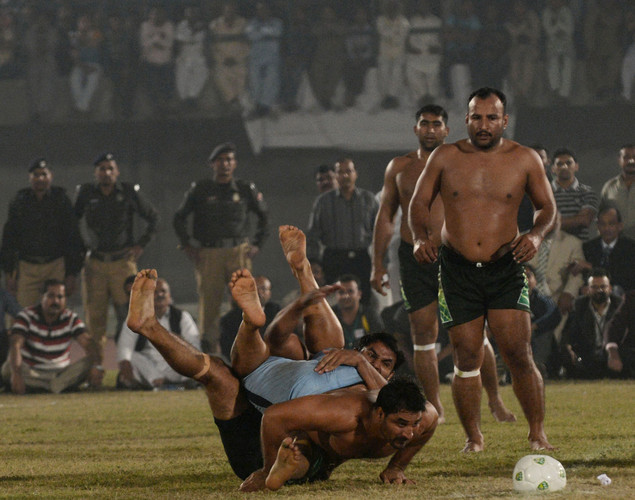 A Pakistani kabbadi player (C) is tackled by his Indian opponent during the Kabaddi Asia Cup final match in Lahore. Pakistan won the 2012 Kabaddi Asia Cup final match against India.