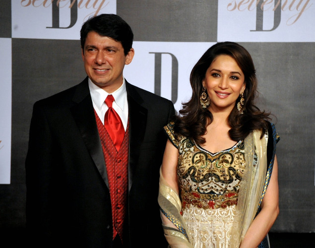 Indian Bollywood actress Madhuri Dixit (R) poses with her husband Shriram Nene as they attend the 70th Birthday celebrations of Bollywood Actor Amitabh Bachchan in Mumbai.