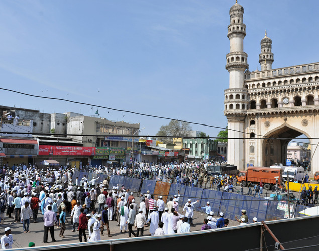 Demonstrating Indian Muslims gather around the barricaded Charminar monument after Friday congregational prayers in the old city section of Hyderabad.
