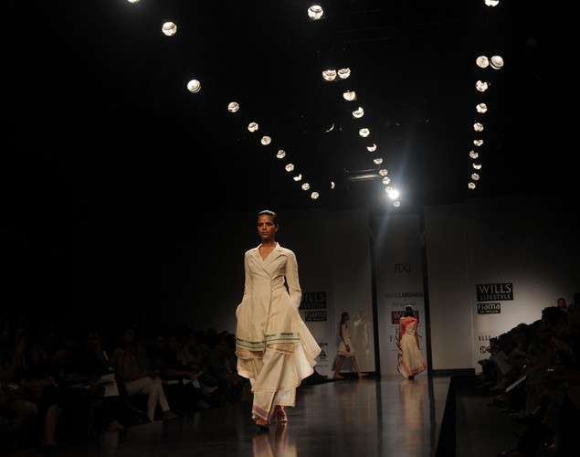 A model presents a creation by Indian designer Rahul Mishra during the third day of the Wills India Fashion Week Spring- Summer collection 2013 in New Delhi.