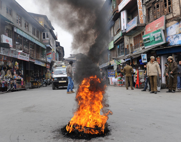 A tyre burns on the street after the news that Pakistan-born Mohammed Kasab, the sole surviving gunman from the 2008 Mumbai attacks was hanged, in Srinagar.