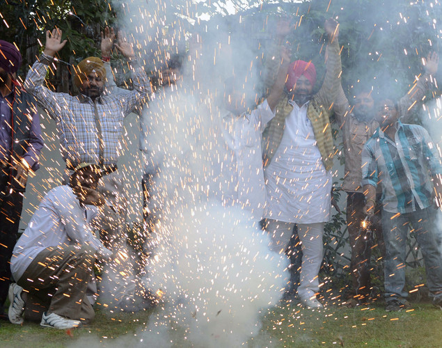 Members of the All India Anti Terrorist Front (AIATF) set off firecrackers as they celebrate the execution of Pakistan-born Mohammed Kasab, who was the sole surviving gunman of the 2008 Mumbai attacks, in Amritsar.
