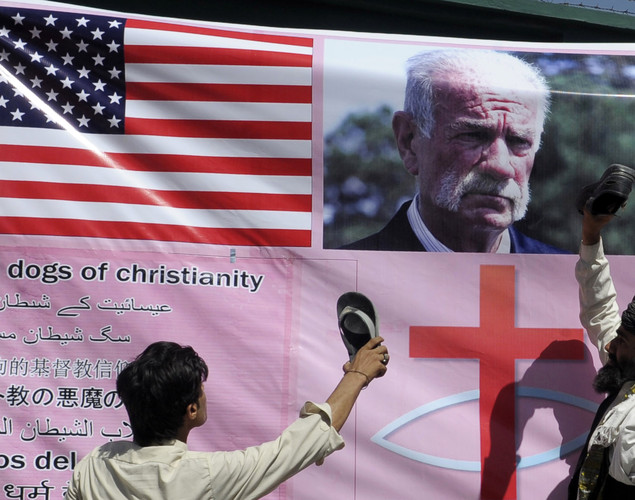 Pakistani Muslim demonstrators react beside the portrait of Florida pastor Terry Jones during a protest against an anti-Islam film in Quetta.
