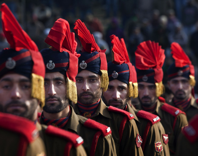 Indian policemen participate in a Republic Day parade in Srinagar, India.