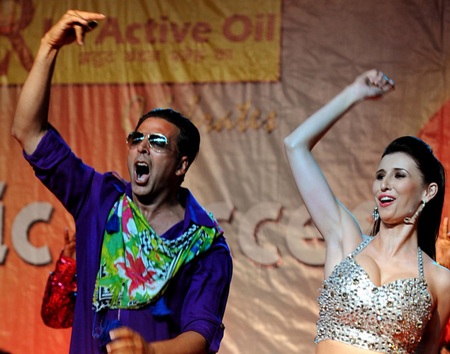 "Indian Bollywood actor Akshay Kumar (L) dances with German model Claudia Ciesla during a promotional event for the forthcoming Hindi film ""Khiladi 786"" directed by Ashish R Mohan in Mumbai."