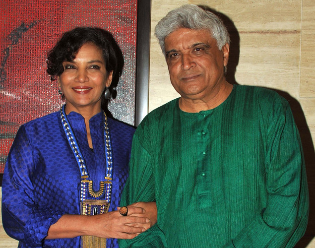 "Bollywood scripwriter Javed Akhtar with wife actress Shabana Azmi pose during a party event for the Hindi film ""Talaash"" in Mumbai."