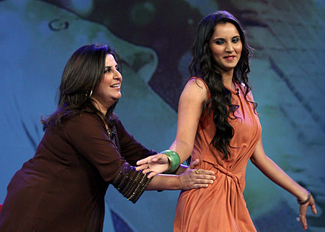 "Indian tennis player Sania Mirza (R) interacts with choreographer Farah Khan on the set of NDTV's television show ""Issi Ka Naam Zindagi"" in Mumbai"