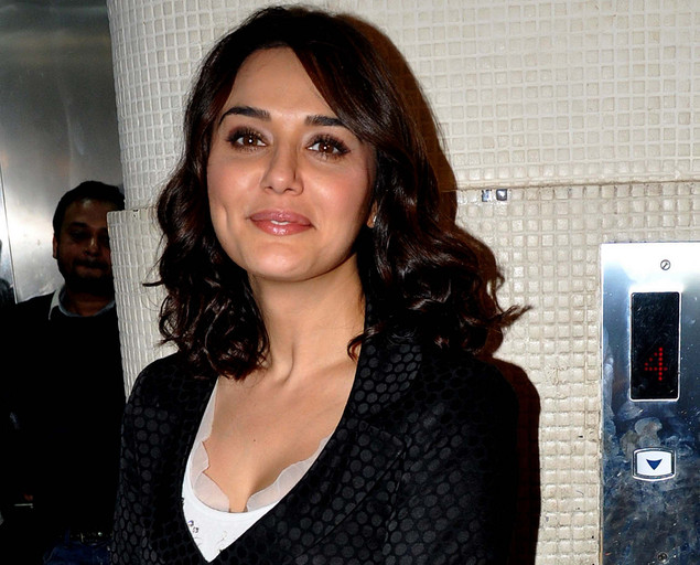 Preity Zinta poses during the launch of singer Sophie Choudry's new