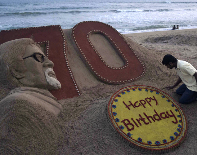 Indian sand artist Sudarshan Pattnaik applies the finishing touches to a sand sculpture of Bollywood's biggest star Amitabh Bachchan a day ahead of his 70th birthday, at the beach in Puri, India.