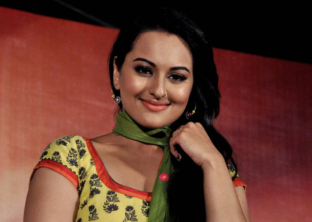 Indian Bollywood film actress Sonakshi Sinha smiles during the launch of the trailer of forthcoming Hindi film 'Rowdy Rathore'.