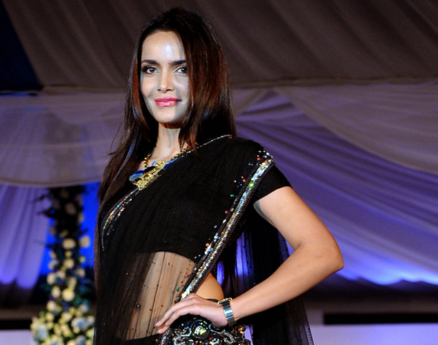 Indian Bollywood actress Shazahn Padamsee displays a creation by designer Neeta Lulla during a fashion show entitled Walk of  peace in Mumbai.