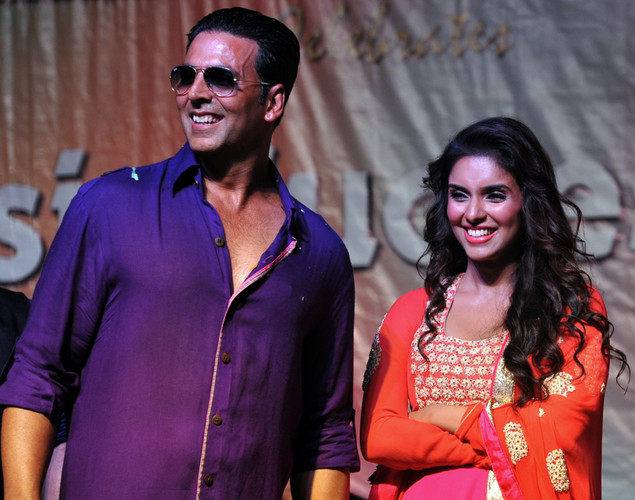 "Indian Bollywood actress Asin Thottumkal (R) poses with actor Akshay Kumar during a promotional event for the forthcoming Hindi film ""Khiladi 786"" directed by Ashish R Mohan in Mumbai."