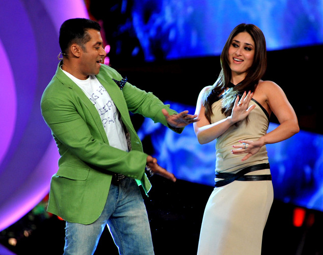 "Bollywood actress Kareena Kapoor (R) performs a song with actor Salman Khan on the set of a television show during the promotion of their forthcoming Hindi film ""Dabbang 2"" in Lonavala."
