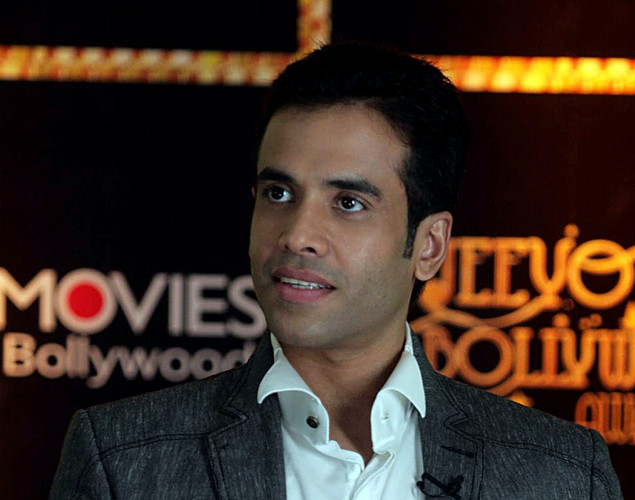 Indian Bollywood film actor Tusshar Kapoor holds the unseen trophy for the 'Best Actor in a Comic Role at the first 'Jeeyo Bollywood Awards' in Mumbai.