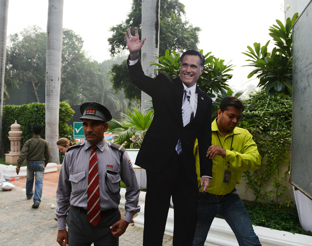 A cutout of US Presidential candidate Mitt Romney is carried away by a catering company worker after a US embassy election party at a local hotel in Delhi.