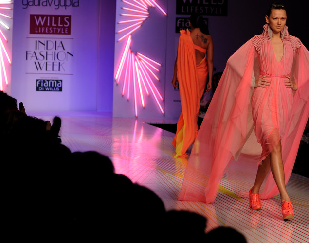 Models present creations by Indian designer Gaurav Gupta during the third day of the Wills India Fashion Week Spring- Summer collection 2013 in New Delhi.