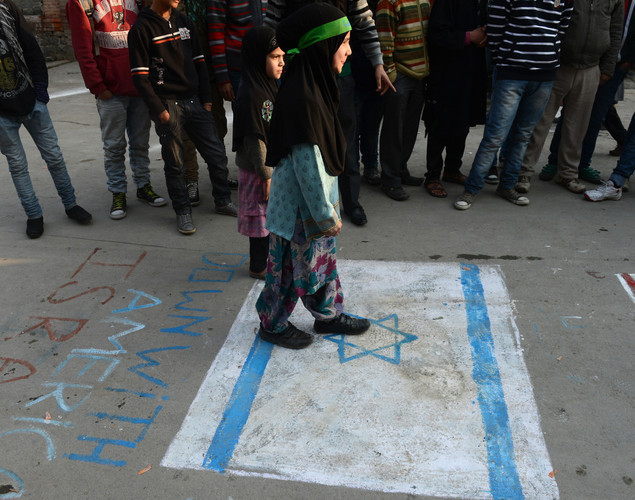 Kashmiri Shiite Muslim children are pictured standing on an Israeli flag painted on the street during a religious procession held on the fourth day of Ashura, which remembers the slaying of the Prophet Mohammed's grandson in southern Iraq in the seventh century, in Srinagar .