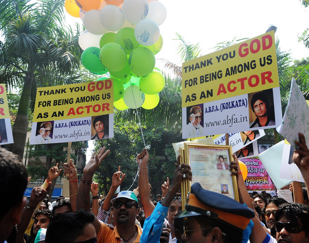 Fans of Indian Bollywood actor Amitabh Bachchan gather outside his residence on his 70th birthday in Mumbai.