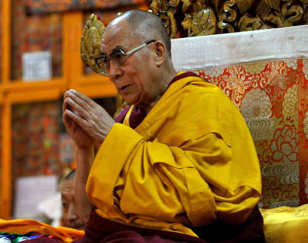 Tibetan Spiritual Leader The Dalai Lama gestures during a prayer meeting at The Namgyal Monastery in Dharamshala.
