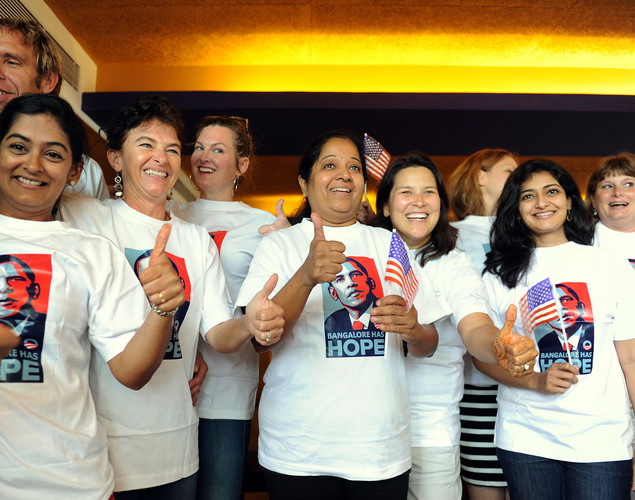 Supporters of re-elected US President Barack Obama pose after a breakfast meeting following the announcement of US Election results in Bangalore.
