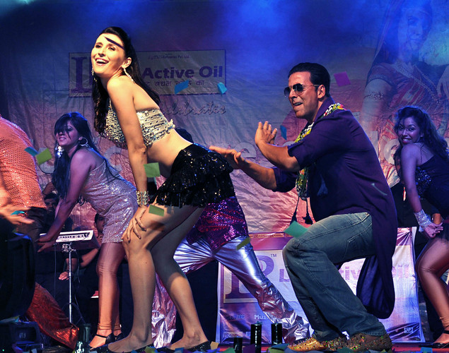 "Indian Bollywood actor Akshay Kumar (R) dances with German model Claudia Ciesla during a promotional event for the forthcoming Hindi film ""Khiladi 786"" directed by Ashish R Mohan in Mumbai."