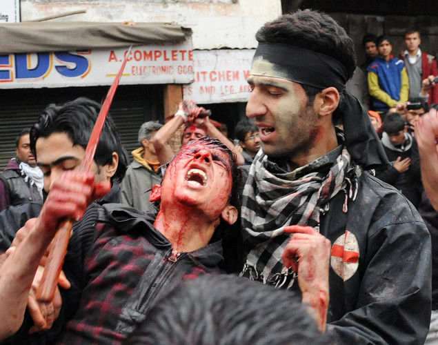Kashmiri Shiite Muslims perform acts of self-flagellation during a religious procession held on the ninth day of Ashura in Srinagar .