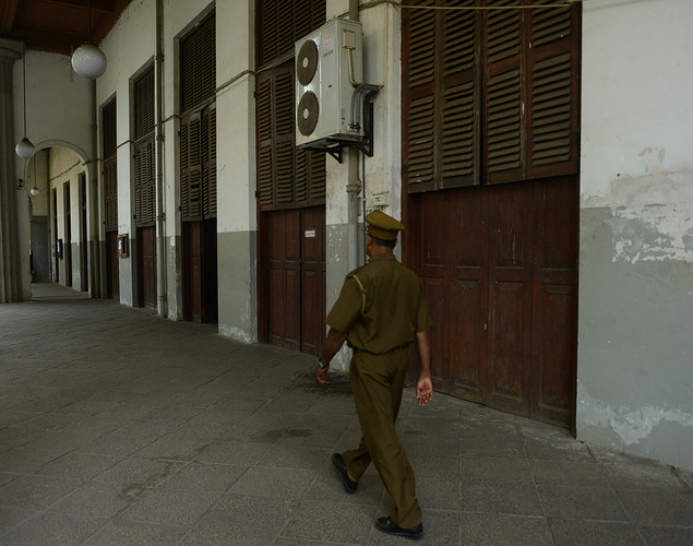 A Sri Lankan police officer guards at an empty High Court as Sri Lankan lawyers stayed away from work during a protest in Colombo.