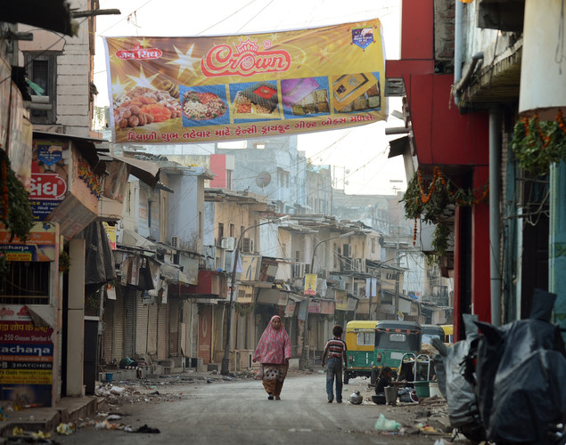A pedestrian walks down a deserted street in the old city of Ahmedabad.