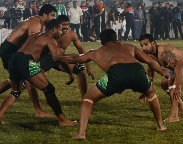 An Indian kabbadi player (R) attemps to tag Pakistani opponents during the Kabaddi Asia Cup final match in Lahore. Pakistan won the 2012 Kabaddi Asia Cup final match against India.