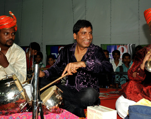 Indian Bollywood actor and comedian (C) Raju Shrivastav performs at a Ganpati celebration during the annual eleven day long Hindu Ganesh Festival in Mumbai.