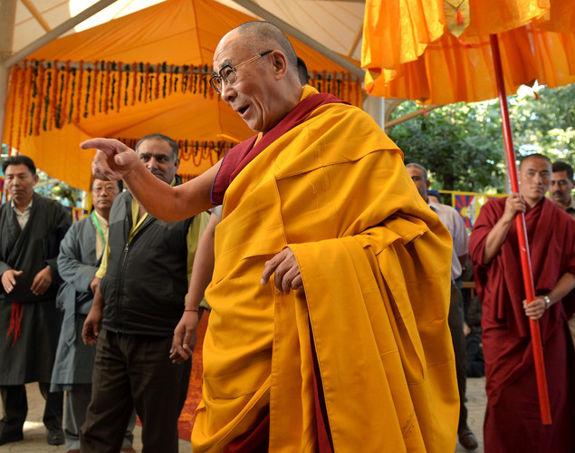 Tibetan Spiritual Leader The Dalai Lama gestures as he arrives to take part in a prayer meeting at The Namgyal Monastery in Dharamshala.