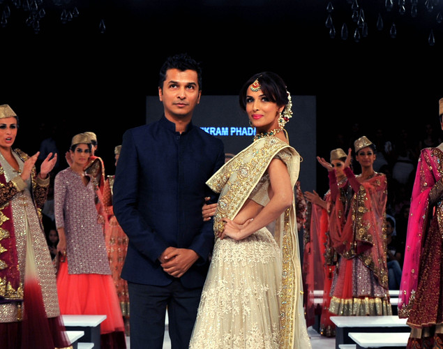 Bollywood actress Malaika Arora Khan (C) displays creations by designer Vikram Phadnis at the 8th edition of Seagram's Blenders Pride Fashion Tour 2012 in Mumbai.