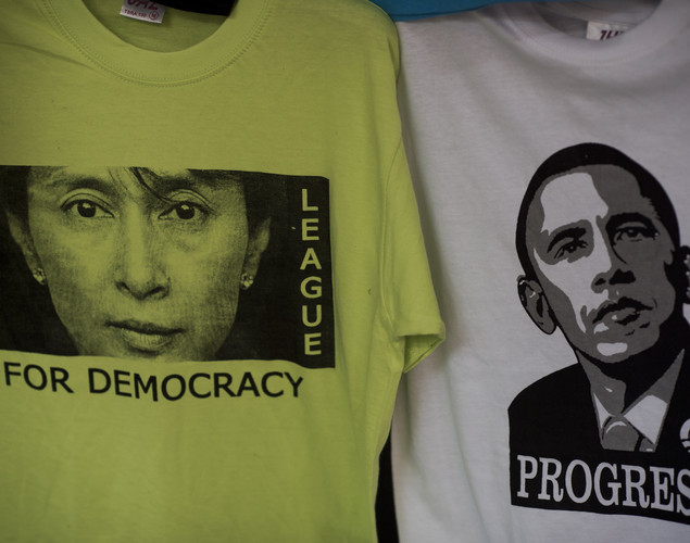 T-shirts of Myanmar pro-democracy leader Aung San Suu Kyi (L) and US President Barack Obama (R) are displayed for sale at a market in Yangon.