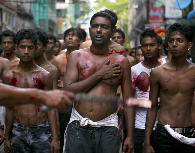 Shia muslims mark the Day of Ashura, striking themselves till they are bloody with razors and chains in Yangon, Myanmar.