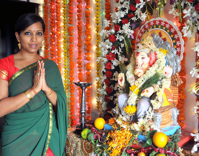 Indian Bollywood actress Meghna Naidu poses as she offers prayers to an idol of Hindu God Lord Ganesh during the festival of 'Ganesh Chaturthi' in Mumbai.