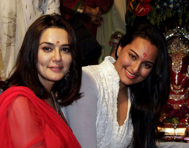 Indian Bollywood actors Preity Zinta (L) and Sonakshi Sinha (R) attend actor Salman Khan's immersion of an elephant-headed Hindi God Lord Ganesh event during a Hindu festival in Mumbai.